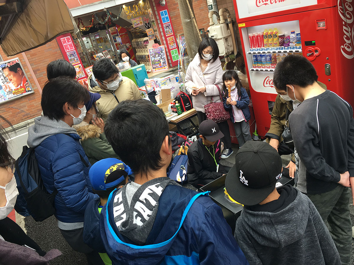 group of people watching beyblade match