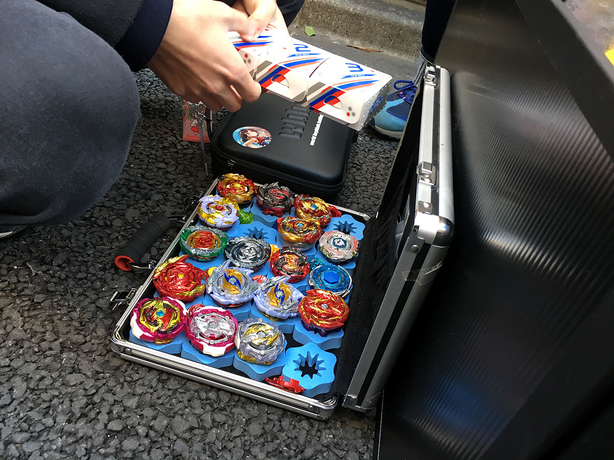 opened attache case filled with beyblades