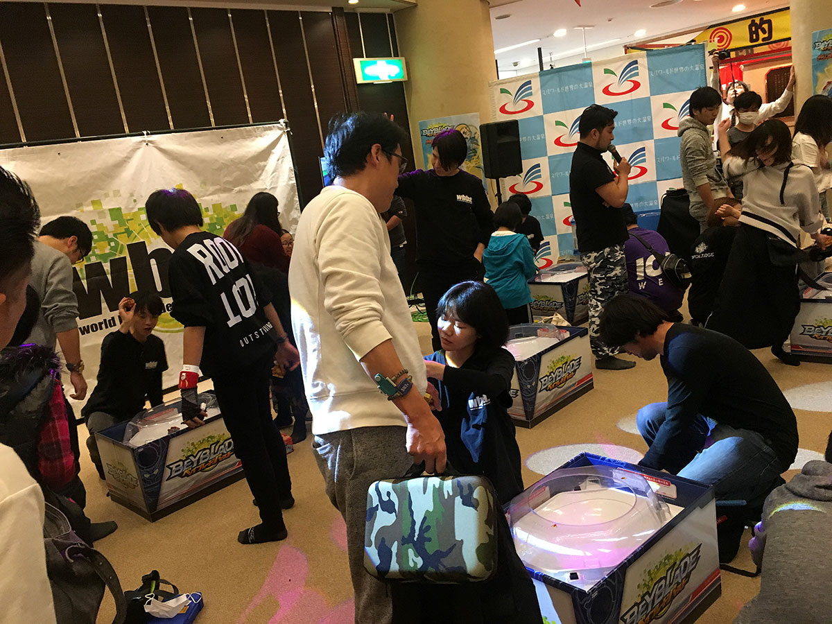 group of beyblade players battling at wide stadiums during g3 tournament