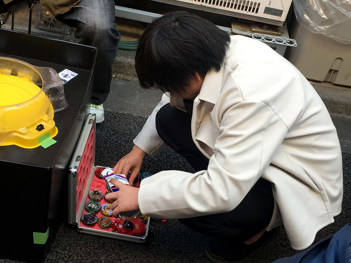 player choosing beyblades from open attache case