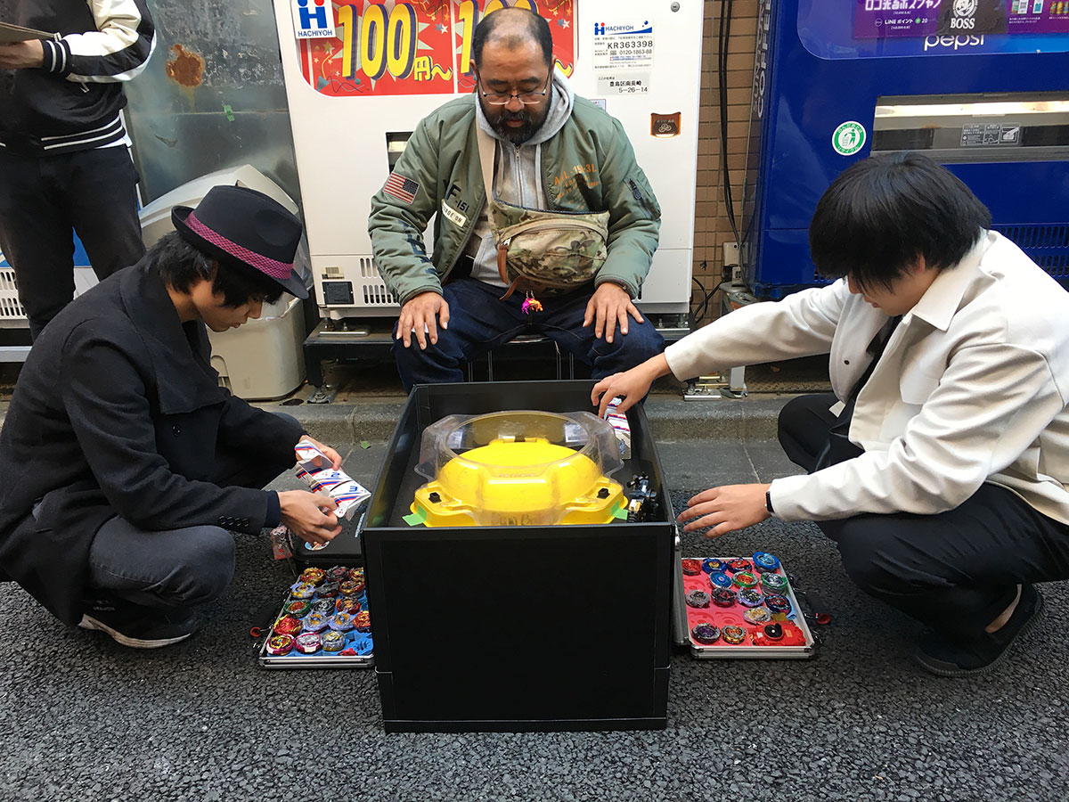 players at beyblade burst tournament prepare beyblades for 3on3 battle format match