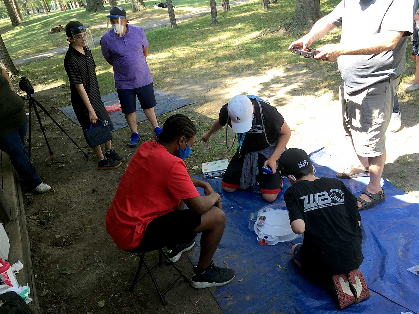 beyblade tournament battle players launching in park