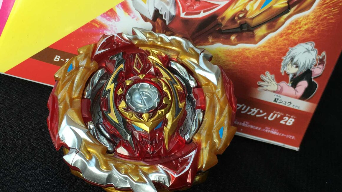 world spriggan beyblade in front of box with shu character