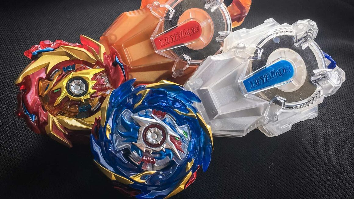 Hyperion Burn and Helios Volcano Beyblades with Long BeyLaunchers