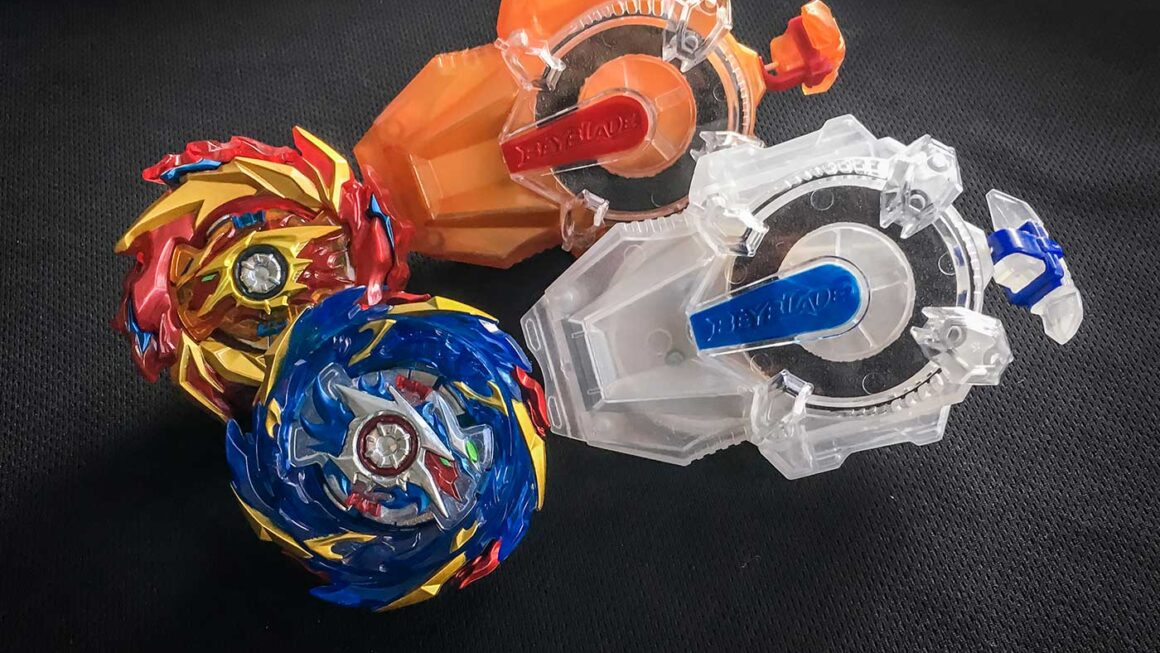 hyperion burn and helios volcano beyblades beside left and right spin long sparking beylaunchers