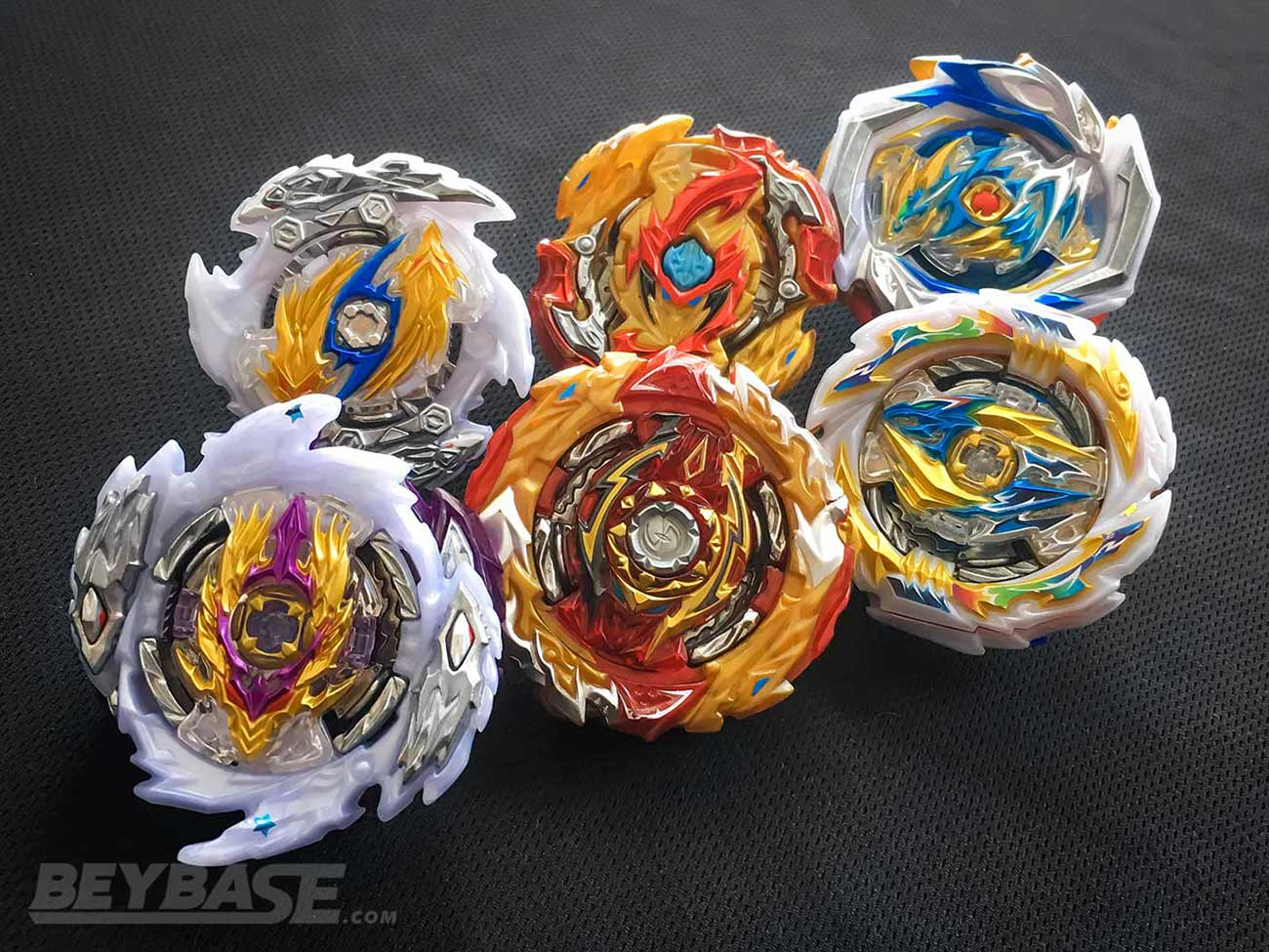beyblade burst sparking longinus spriggan and dragon evolutions in front of cho-z versions