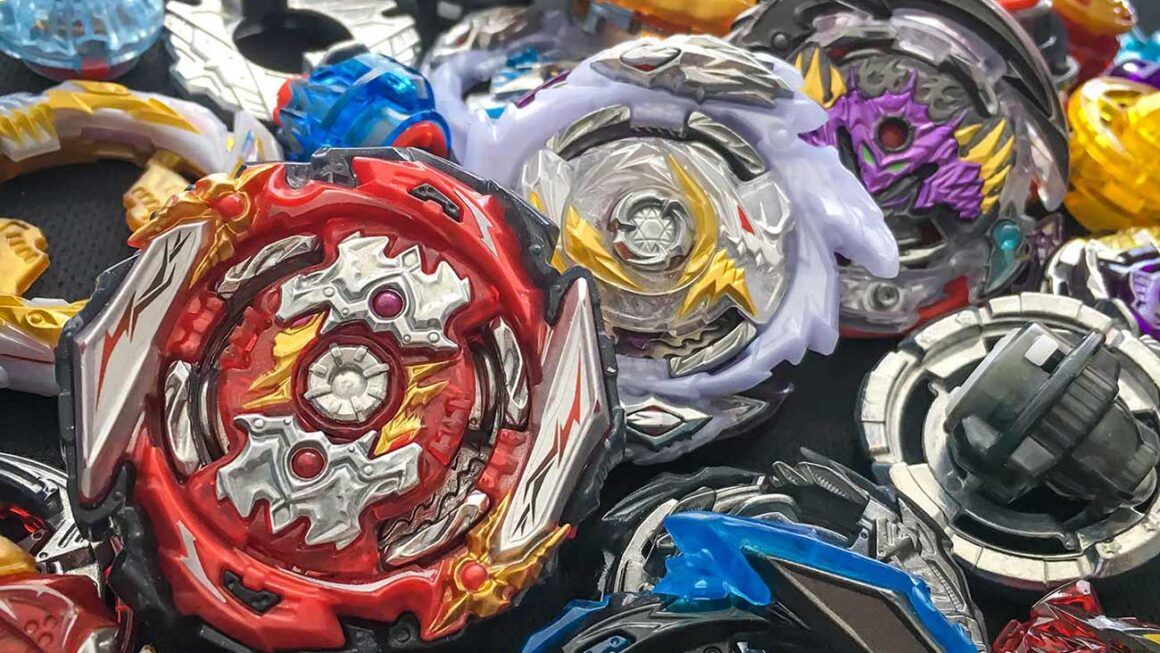 three beyblade burst combos surrounded by an assortment of parts