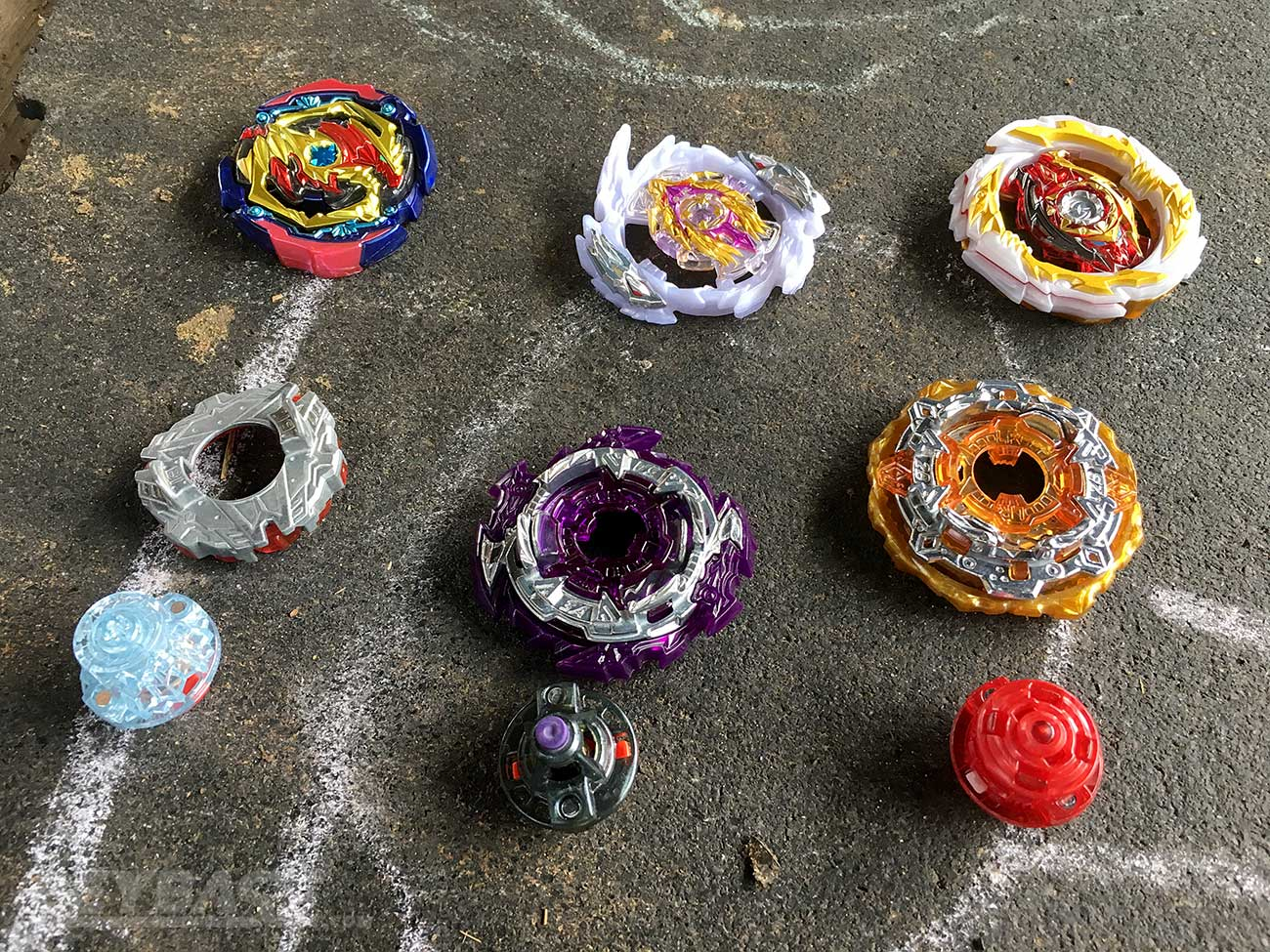 three disassembled beyblade combos