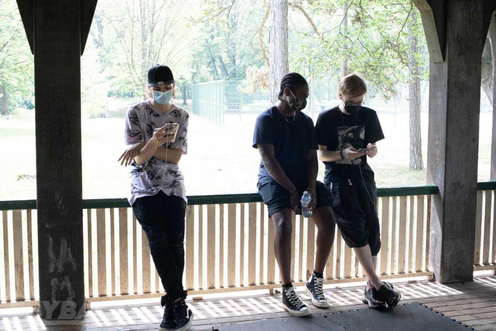 1234beyblade, justin tc, and kei sitting on railing of shelter